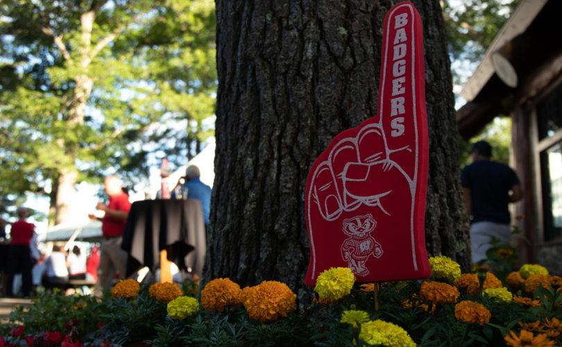 Wisconsin big foam hand against tree